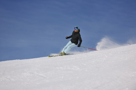 young healthy woman skiing on fresh snow at winter season in france alps photo