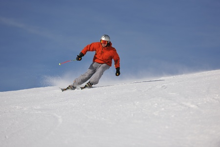 young athlete man have fun during skiing sport on hi mountain slopes at winter seasson and sunny day photo