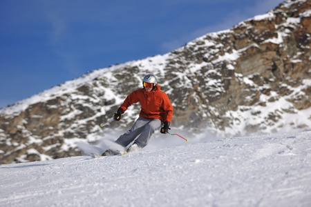 young athlete man have fun during skiing sport on hi mountain slopes at winter seasson and sunny day Stock Photo - 9073248