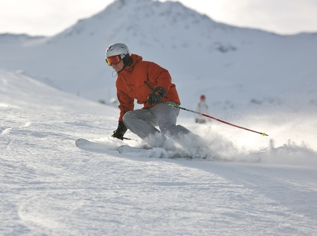 downhill: young athlete man have fun during skiing sport on hi mountain slopes at winter seasson and sunny day