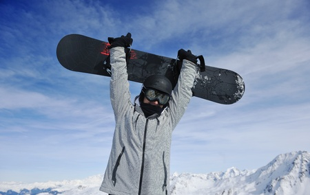 young athlete man have fun during skiing sport on hi mountain slopes at winter seasson and sunny day Stock Photo - 9074308
