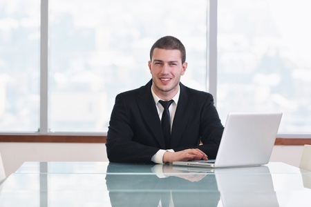 young business man lawyer with laptop alone in big bright   conference room Stock Photo - 9072461