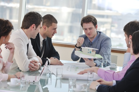 group of architect business team people on meeting looking model and desing of new real estate house Stock Photo - 9296227