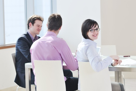 happy young business people group have  meeting at conference room and argue about new ideas and plans Stock Photo - 9077381