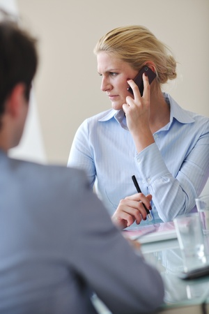 blonde young business woman talk by cellphone on meetng Stock Photo - 9077429