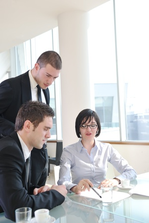 young business people group have  meeting at conference room and have discusion  about new ideas  plans and problems Stock Photo - 9076163