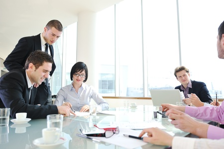 young business people group have  meeting at conference room and have discusion  about new ideas  plans and problems Stock Photo - 9076159