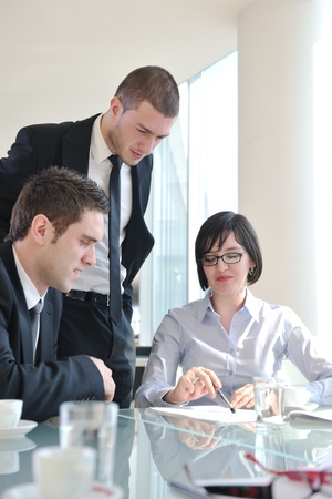 young business people group have  meeting at conference room and have discusion  about new ideas  plans and problems Stock Photo - 9076192