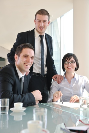 young business people group have  meeting at conference room and have discusion  about new ideas  plans and problems Stock Photo - 9076191