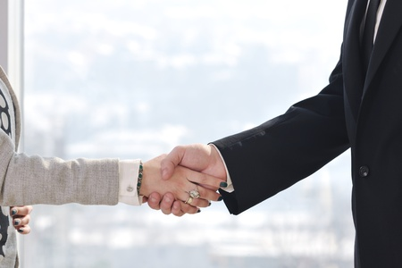 trust people: business man and woman handshake on successful  meeting at bright office conference room indoor Stock Photo