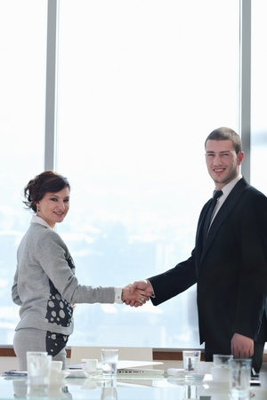 business man and woman handshake on successful  meeting at bright office conference room indoor photo