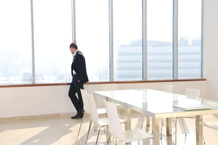 conferences: young business man lawyer with laptop alone in big bright   conference room Stock Photo