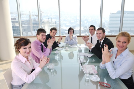 young business people group have  meeting at conference room and have discusion  about new ideas  plans and problems photo