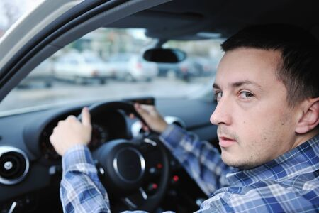 car navigation: young man using new car navigation and onboard vehicle transport system