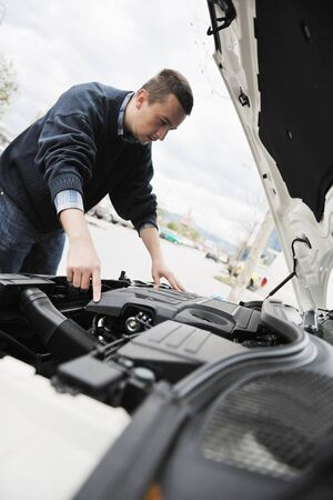 man looking at new car vihicle engine and try to find probelm at repair fix and maintanance service photo