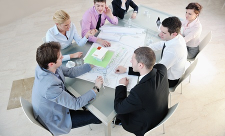 young business people group have  meeting at conference room and have discusion  about new ideas  plans and problems Stock Photo - 9201215