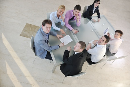 young business people group have  meeting at conference room and have discusion  about new ideas  plans and problems Stock Photo - 9201222