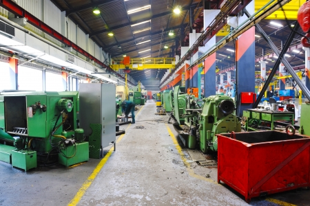 factory worker: industry factory iron works steel and machine parts modern indoor hall for assambly