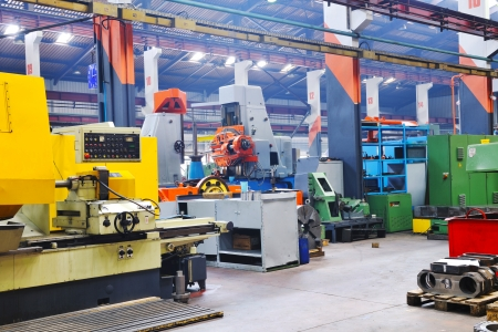industrial machine: industry factory iron works steel and machine parts modern indoor hall for assambly