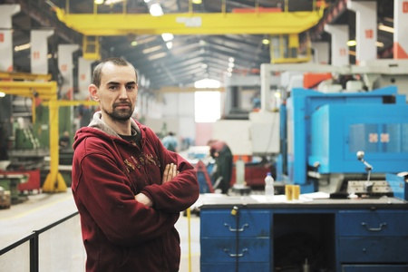 factory worker: engineering people manofacturing industry with big modern computer mashines i company  hall