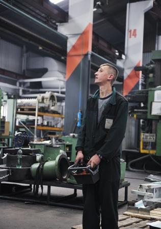 engineering people manofacturing industry with big modern computer mashines i company  hall photo