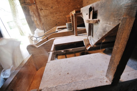 original old wheat mill in use on coutryside for organic and eco food photo