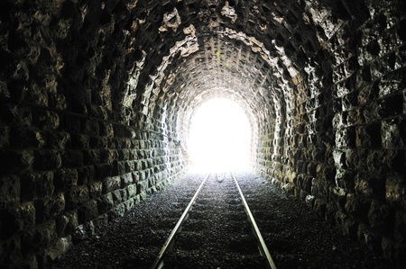high end: light on end of train tunnel representing new life and success concept