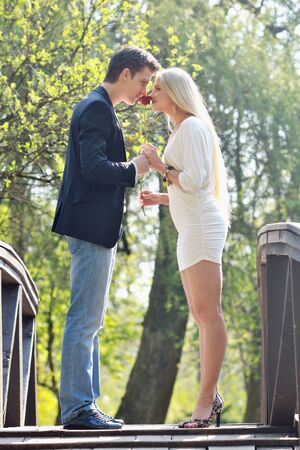 happy young romantic couple in love dance outdoor at spring season on early mornig with beautiful light Stock Photo - 9393667