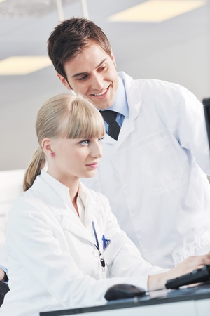 science and research biology chemistry an dmedicine  youn people couple in bright modern  lab Stock Photo - 9404566
