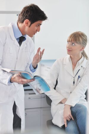 science and research biology chemistry an dmedicine  youn people couple in bright modern  lab Stock Photo - 9404548