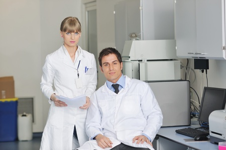 science and research biology chemistry an dmedicine  youn people couple in bright modern  lab Stock Photo - 9404572