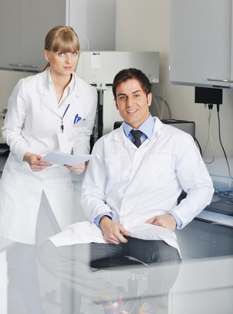 science and research biology chemistry an dmedicine  youn people couple in bright modern  lab Stock Photo - 9404569