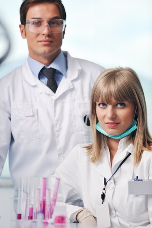 science and research biology chemistry an dmedicine  youn people couple in bright modern  lab photo