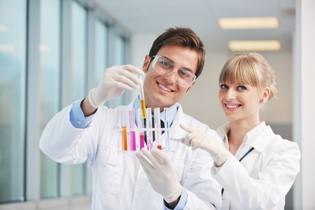 science and research biology chemistry an dmedicine  youn people couple in bright modern  lab Stock Photo - 9432604