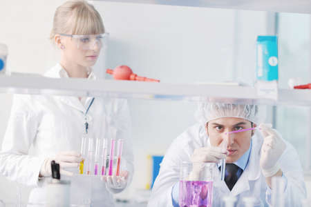 science and research biology chemistry an dmedicine  youn people couple in bright modern  lab Stock Photo - 9429117