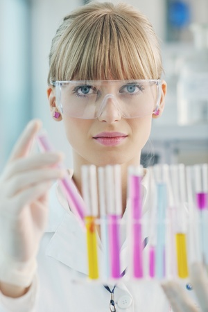 doctor student  female researcher holding up a test tube in chemistry bright labaratory Stock Photo - 9432603