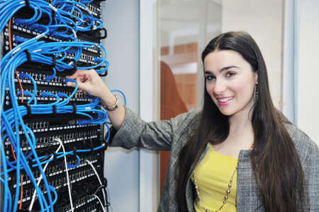 network server: woman it engineer in network server room solving problems and give help and support