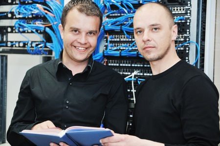 it support: it engineer in network server room solving problems and give help and support