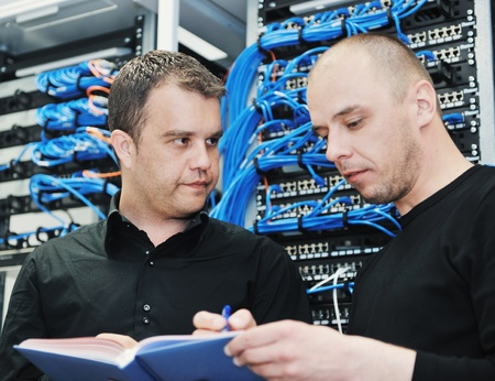 it engineer in network server room solving problems and give help and support Stock Photo - 9481675