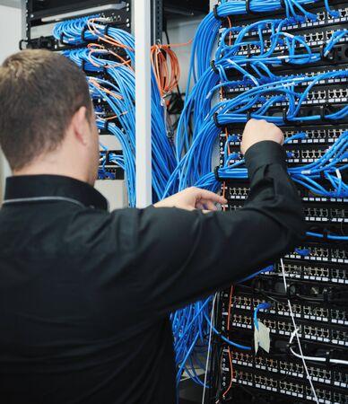 engeneer: young it engeneer in datacenter server room