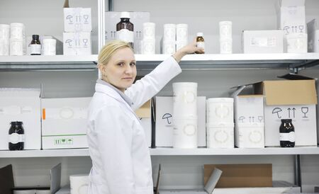 woman worker in pharmacy company warehouse photo
