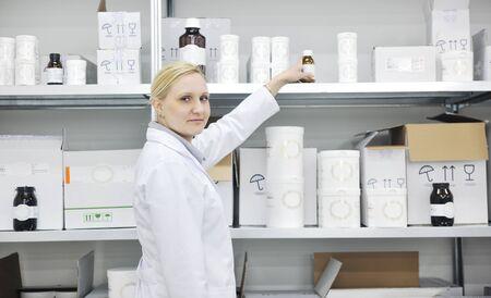 woman worker in pharmacy company warehouse photo