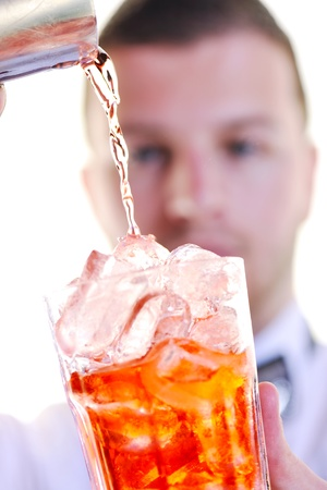 young barman portrait isolated on white background with alcohol coctail drink photo