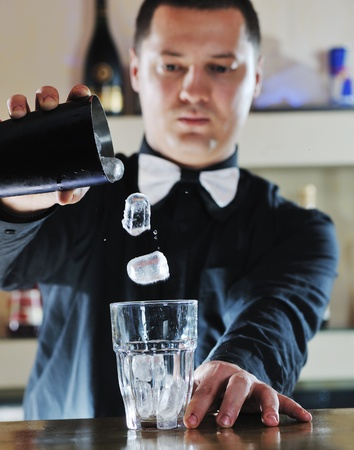 cocktail shaker: pro barman prepare coctail drink and representing nightlife and party event  concept