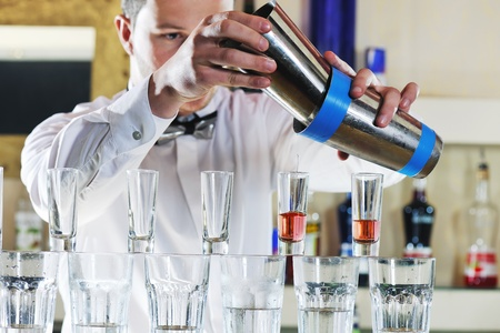 pouring beer: pro barman prepare coctail drink and representing nightlife and party event  concept