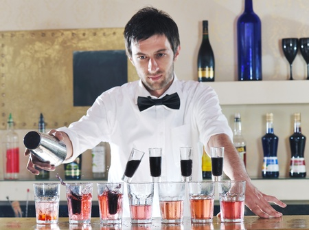 shaker: pro barman prepare coctail drink and representing nightlife and party event  concept