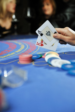 jack of clubs: woman play black jack card game in casino on blue table