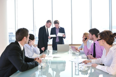 young business people group have  meeting at conference room and have discusion  about new ideas  plans and problems Stock Photo - 9619447