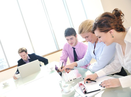young business people group have  meeting at conference room and have discusion  about new ideas  plans and problems Stock Photo - 9619438