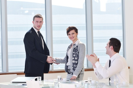 young business people group have  meeting at conference room and have discusion  about new ideas  plans and problems Stock Photo - 9619463